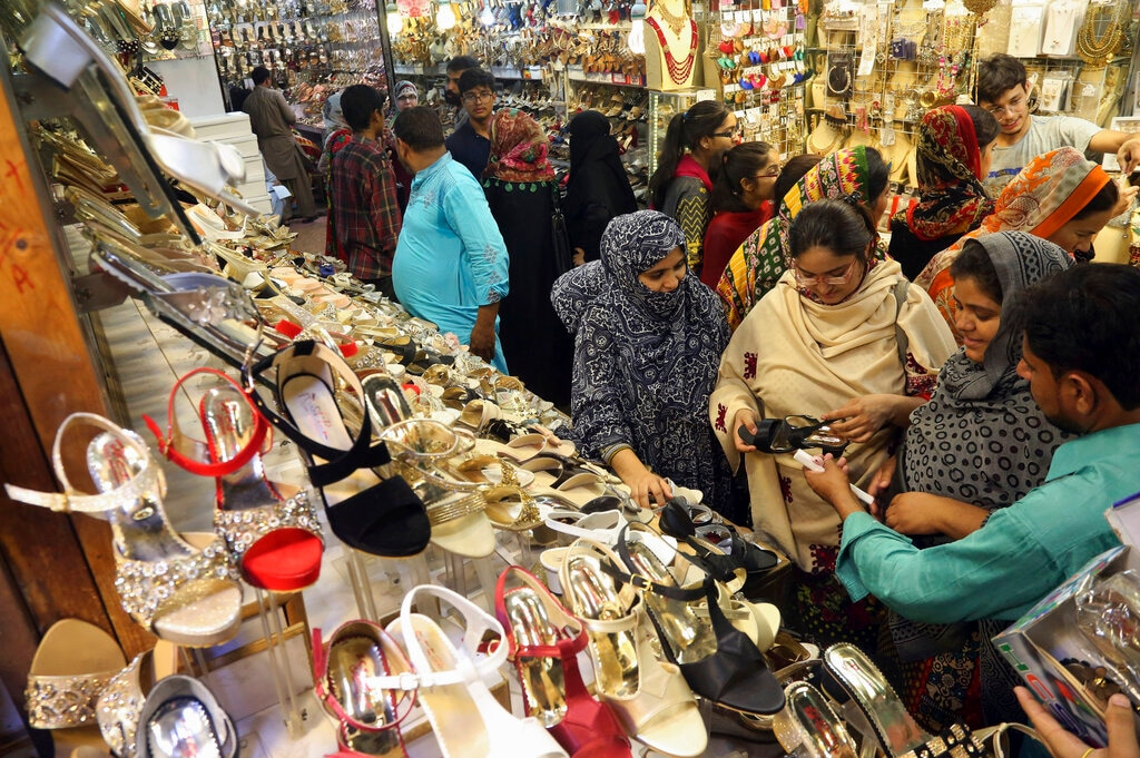 Women visit a market to buy shoes and other items in preparation for the upcoming Eid al-Fitr celebrations, in Lahore, Pakistan, Sunday, June 2, 2019. (AP Photo/K.M. Chaudary)