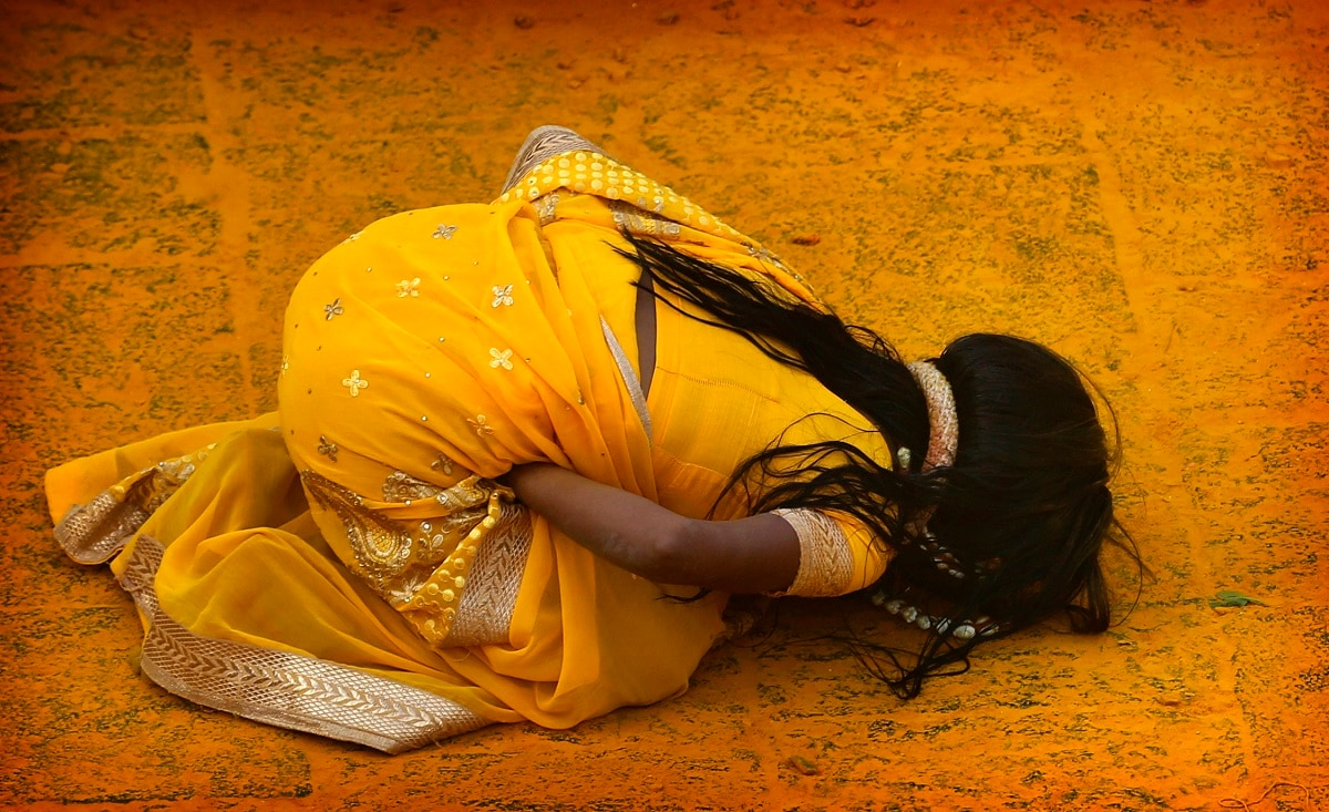 A devotee covered in the spice turmeric goes into a trance during the celebration of the Bhandara Festival. (AP Photo/Rafiq Maqbool)
