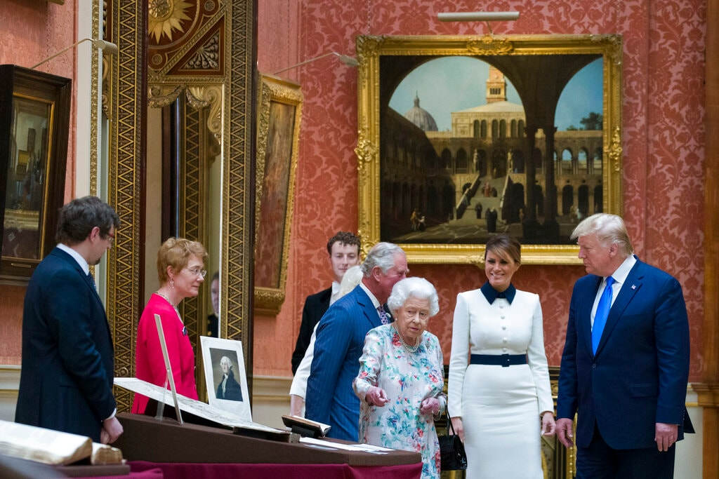 Queen Elizabeth II shows items in the Royal Gifts collection to first lady Melania Trump and President Donald Trump at Buckingham Palace, Monday, June 3, 2019, in London. (AP Photo/Alex Brandon)