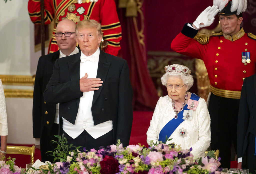 US President Donald Trump left and Queen Elizabeth II stand, during the State Banquet at Buckingham Palace, in London, Monday, June 3, 2019. (Dominic Lipinski/Pool Photo via AP)