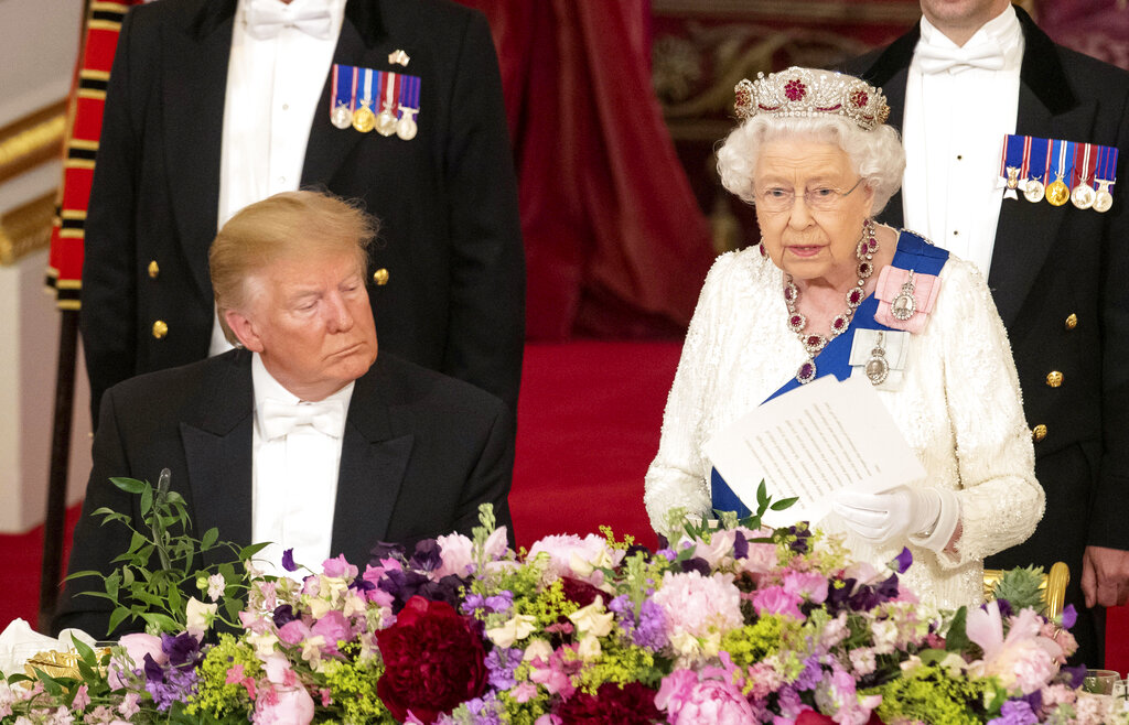 US President Donald Trump, left, listens as Britain's Queen Elizabeth II delivers a speech, during the State Banquet at Buckingham Palace, in London, Monday, June 3, 2019. (Dominic Lipinski/Pool Photo via AP)