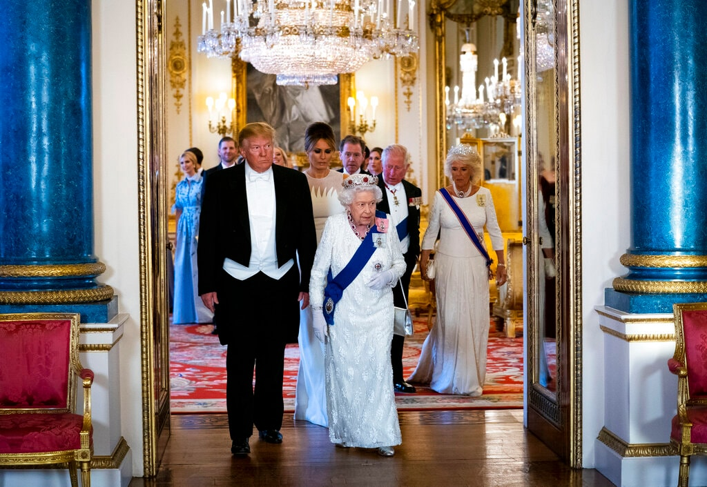 President Donald Trump and first lady Melania Trump walk with Queen Elizabeth II, followed by first lady Melania Trump, Prince Charles, and Camilla, Duchess of Cornwall as they make their way into the Music Room for a State Banquet at Buckingham Palace, Monday, June 3, 2019, in London. (Doug Mills/Pool Photo via AP)