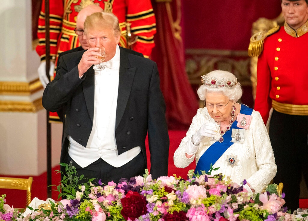 US President Donald Trump left and Queen Elizabeth II toast, during the State Banquet at Buckingham Palace, in London, Monday, June 3, 2019. (Dominic Lipinski/Pool Photo via AP)