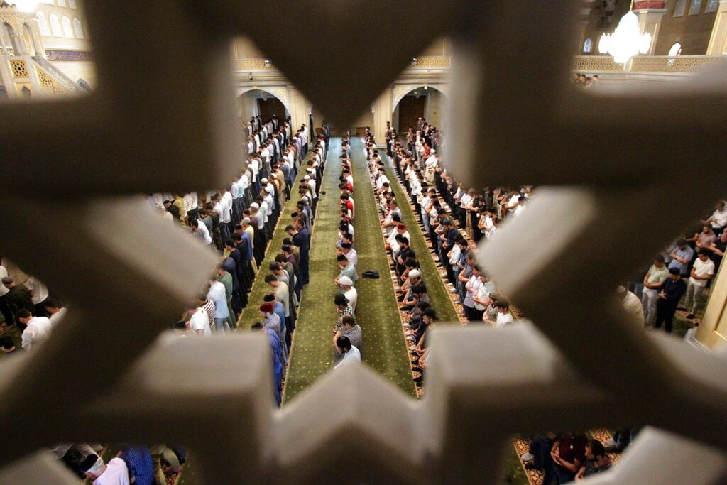 Muslims pray in a mosque during celebrations of Eid al-Fitr holiday, a feast celebrated by Muslims worldwide, in Grozny, Russia, Tuesday, June 4, 2019. (AP Photo/Musa Sadulayev)