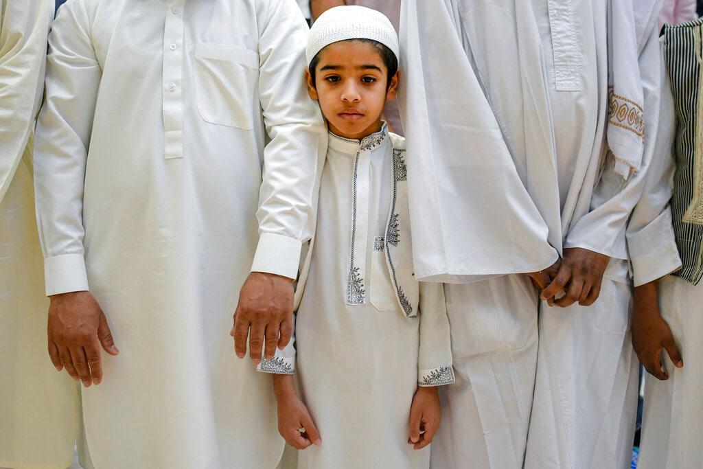 A boy attends Eid al-Fitr prayers in Bucharest, Romania, Tuesday, June 4, 2019. (AP Photo/Andreea Alexandru)