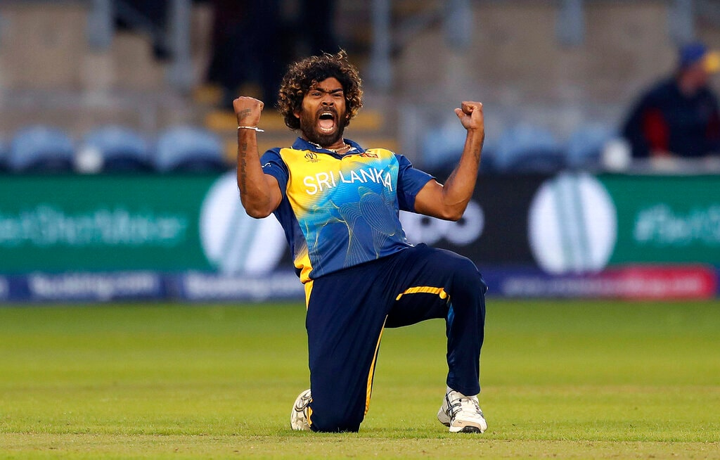 Sri Lanka's Lasith Malinga celebrates taking the wicket of Afghanistan's Hamid Hassan during the Cricket World Cup group stage match between Sri Lanka and Afghanistan at the Cardiff Stadium, Wales, Tuesday, June 4, 2019. (David Davies/PA via AP)