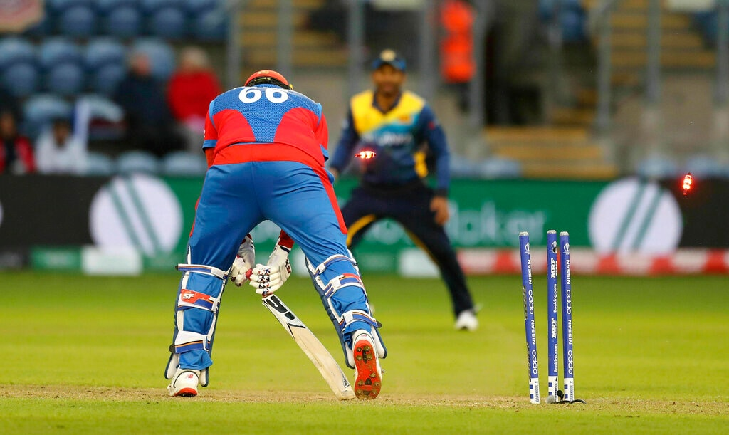 Afghanistan's Hamid Hassan is bowled by Sri Lanka's Lasith Malinga during the Cricket World Cup group stage match between Sri Lanka and Afghanistan at the Cardiff Stadium, Wales, Tuesday, June 4, 2019. (David Davies/PA via AP)