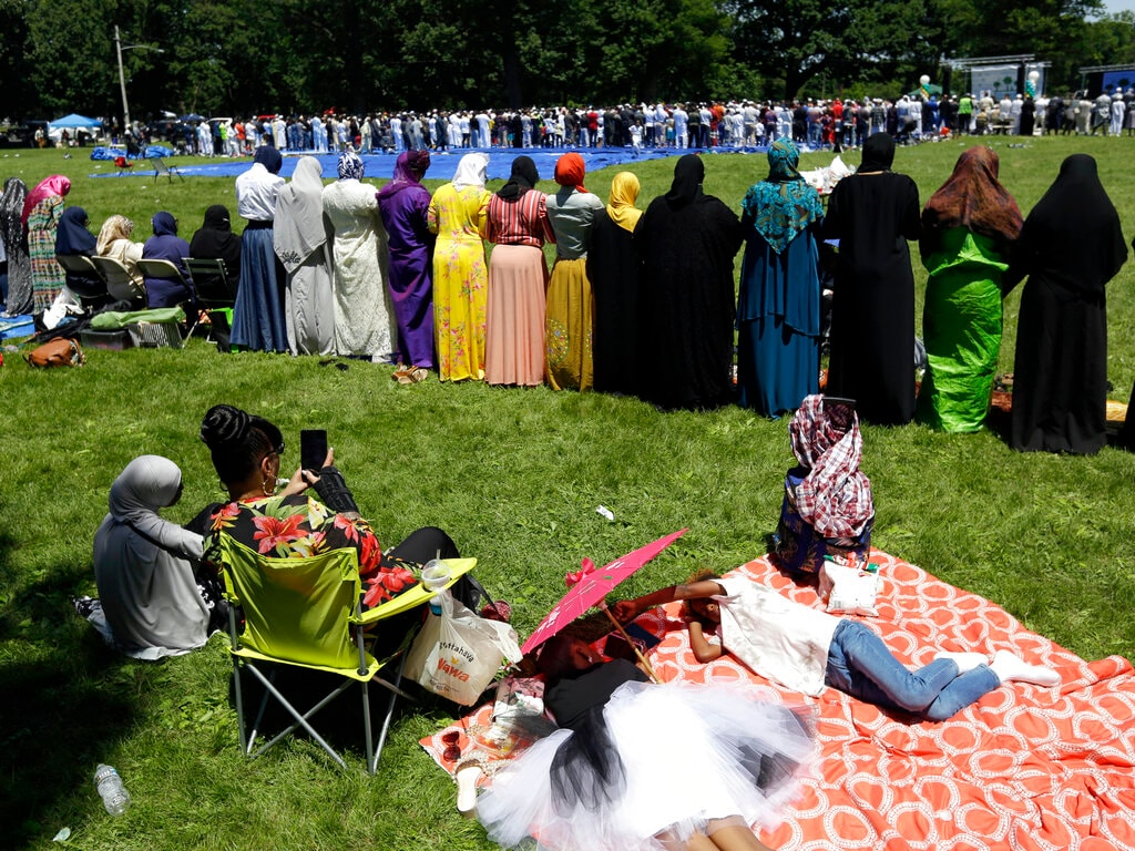 Muslim women and men participate in the Dhuhr mid-afternoon prayers during Eid in the Park 2019 on Eid al-Fitr, which marks the end of the holy fasting month of Ramadan, Tuesday, June 4, 2019, in Philadelphia's Fairmount Park. (AP Photo/Jacqueline Larma)