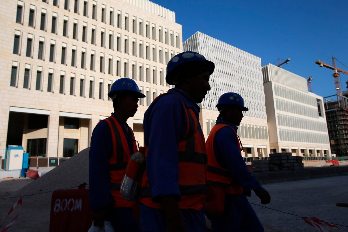 Workers leave their construction sites at the Msheireb Downtown Doha district in Doha, Qatar. (AP Photo/Kamran Jebreili)