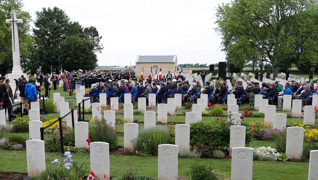 Canadian World War II veterans and other guests attend a commemoration ceremony at the Beny-sur-Mer Canadian War Cemetery in Reviers, Normandy, France, Wednesday, June 5, 2019. (AP Photo/David Vincent)