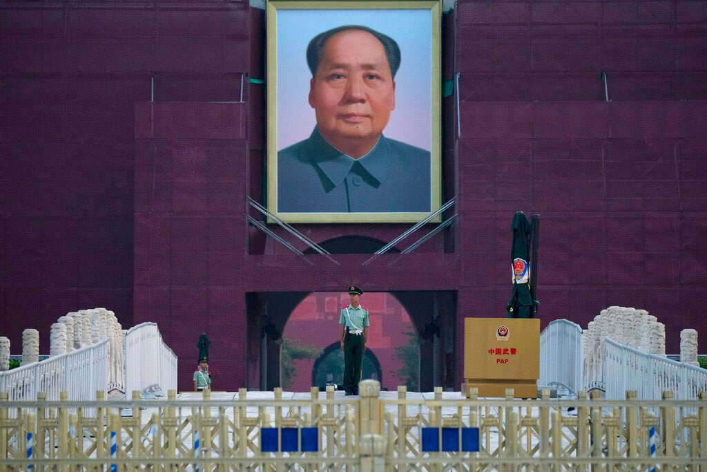 A paramilitary policeman stands guard in front of Mao Zedong's portrait on Tiananmen Gate during the 30th anniversary of a deadly crackdown on pro-democracy protesters in Beijing on Tuesday, June 4, 2019. Critics say the 1989 Tiananmen Square crackdown left hundreds, possibly thousands, dead. (AP Photo/Ng Han Guan)