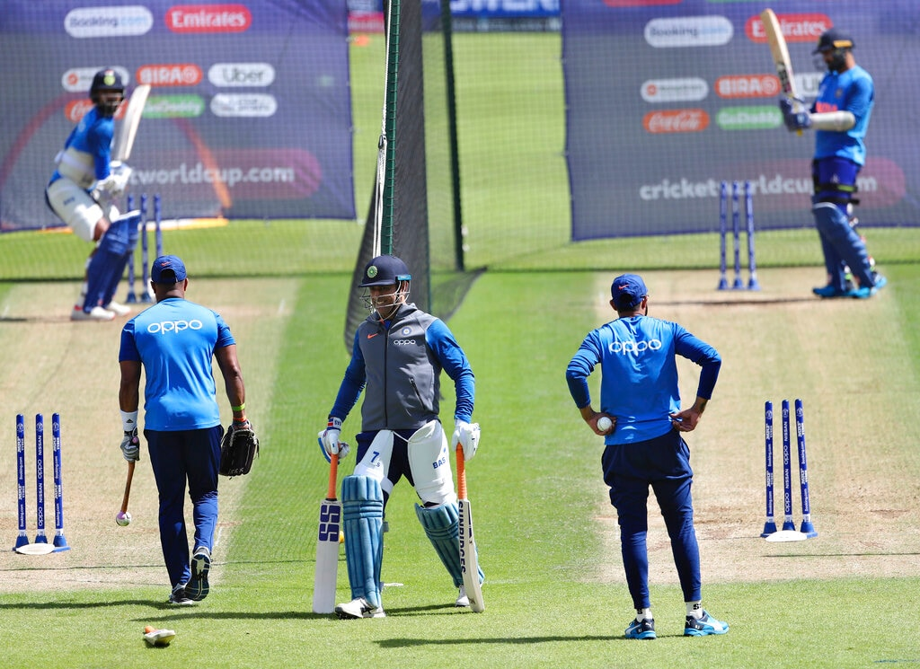 India's MS Dhoni, center, walks between the nets during a training session ahead of their Cricket World Cup match against Australia. (AP Photo/Aijaz Rahi)