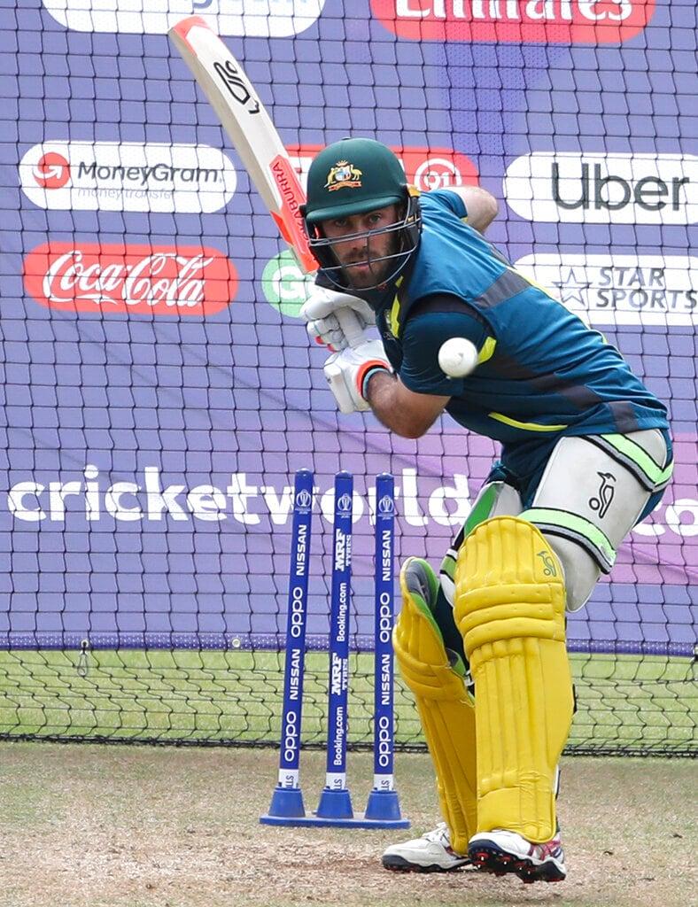 Australia's Glenn Maxwell bats in the nets during a training session ahead of their Cricket World Cup match against India. (AP Photo/Aijaz Rahi)