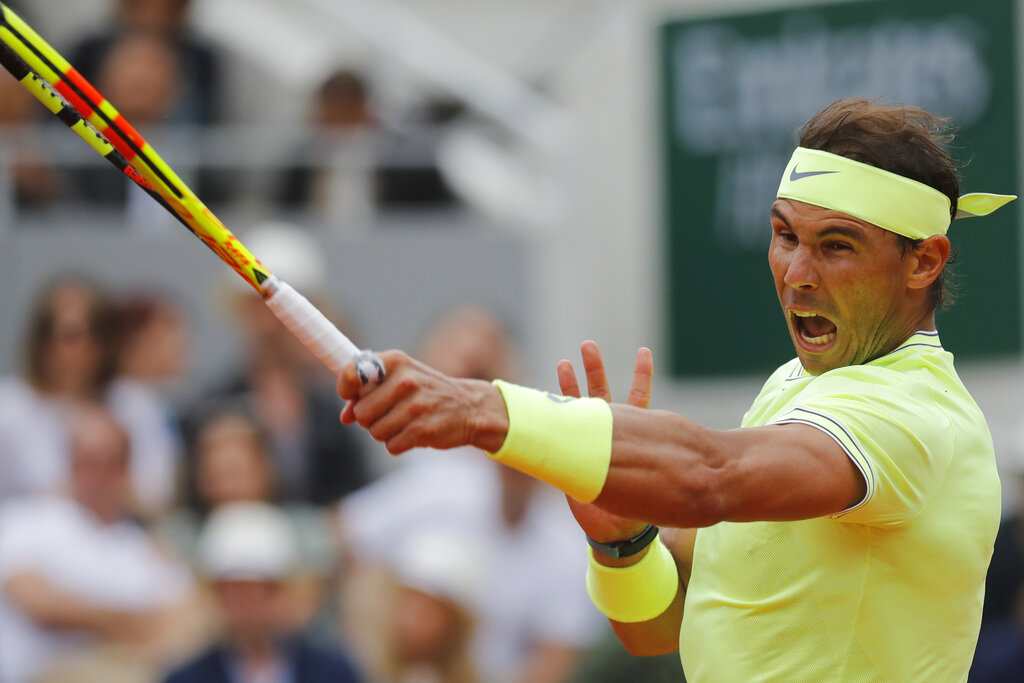 Spain's Rafael Nadal plays a shot against Austria's Dominic Thiem during the men's final match of the French Open tennis tournament at the Roland Garros stadium in Paris, Sunday, June 9, 2019. (AP Photo/Michel Euler)