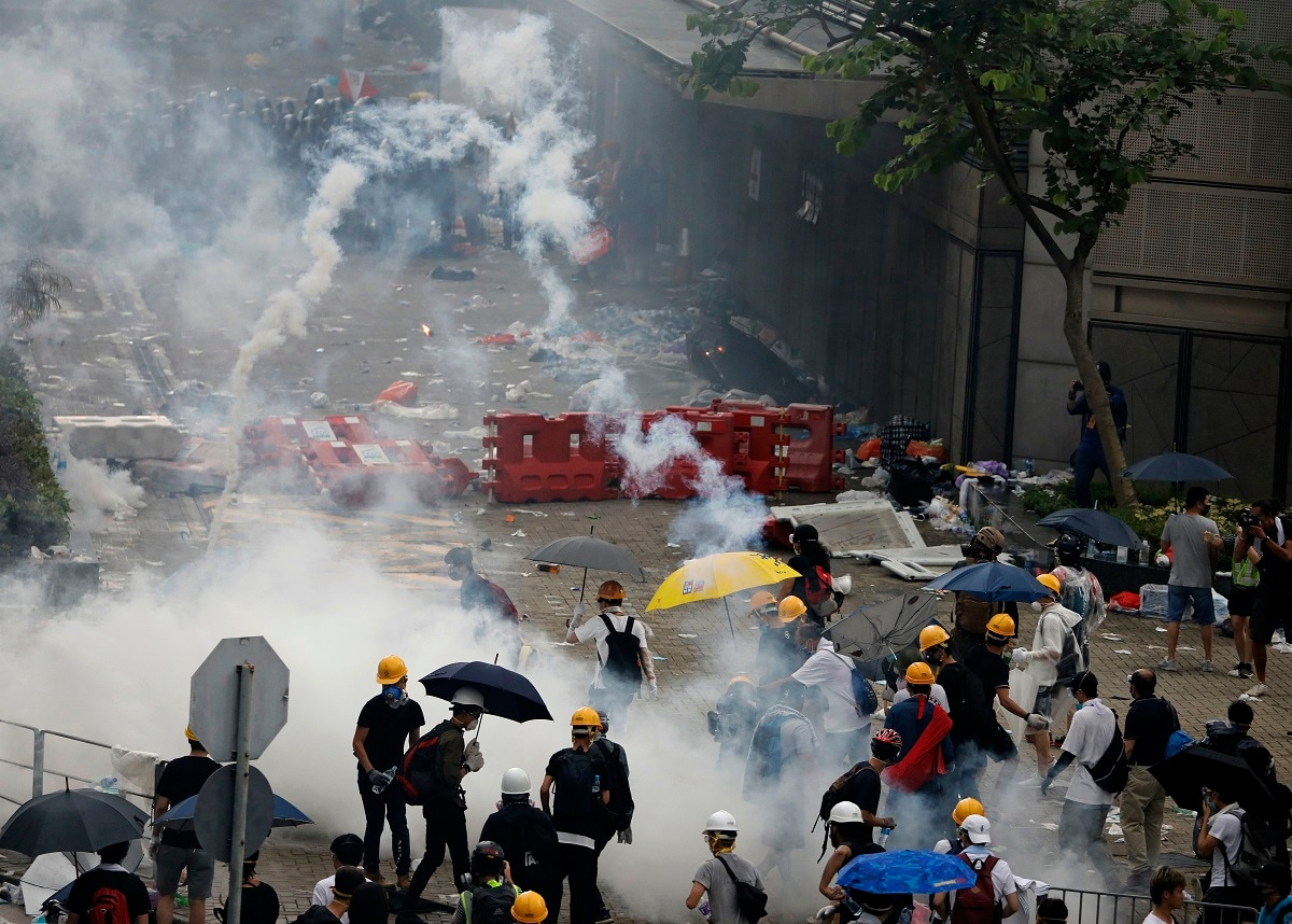 Hong Kong activists who clashed with police in some of the territory's biggest violence are vowing to keep protesting an extradition bill that has become a lightning rod for concerns over Chinese control and eroding freedoms. (AP Photo/Vincent Yu)
