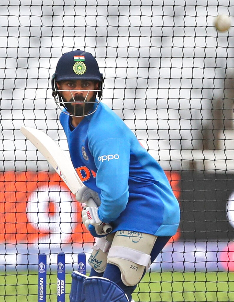 India's captain Virat Kohli bats in the nets during a training session ahead of their Cricket World Cup match against New Zealand at Trent Bridge in Nottingham, England, Wednesday, June 12, 2019. (AP Photo/Aijaz Rahi)