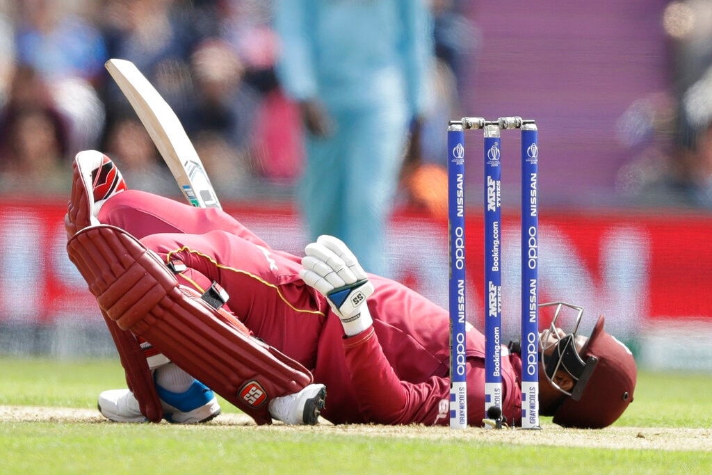 West Indies' Shimron Hetmyer lies back on the pitch after ducking a bouncer during the Cricket World Cup match between England and West Indies at the Hampshire Bowl in Southampton, England, Friday, June 14, 2019. (AP Photo/Matt Dunham)