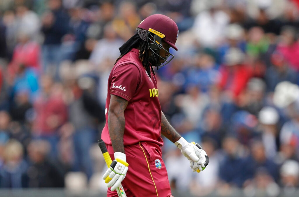 West Indies' Chris Gayle walks off the field of play after losing his wicket from the bowling of England's Liam Plunkett during the Cricket World Cup match between England and West Indies at the Hampshire Bowl in Southampton, England, Friday, June 14, 2019. (AP Photo/Matt Dunham)