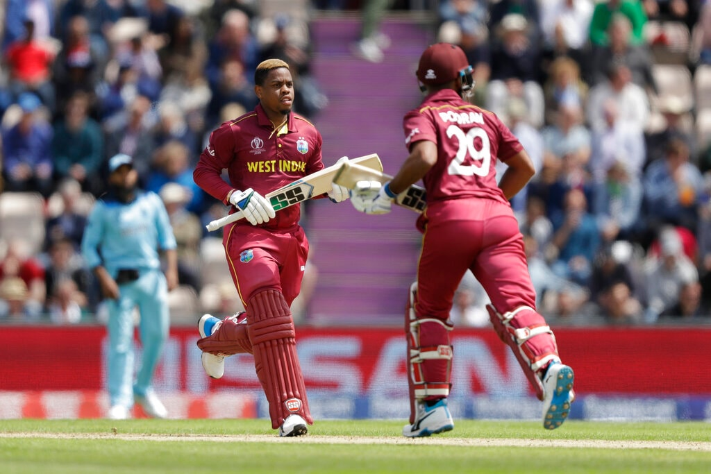 West Indies' Shimron Hetmyer, left, and West Indies' Nicholas Pooran adds runs during the Cricket World Cup match between England and West Indies at the Hampshire Bowl in Southampton, England, Friday, June 14, 2019. (AP Photo/Matt Dunham)