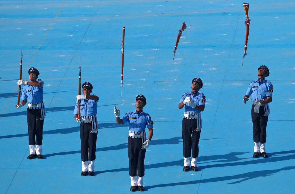 Indian Air Force (IAF) Air Warrior drill team displays rifle handling skills during a combined graduation parade at Air Force Academy, outskirts of Hyderabad, India, Saturday, June 15, 2019. A total of 152 flight cadets including 24 women officers were commissioned as flying officers on Saturday on successful completion of their training, a press release said. (AP Photo/Mahesh Kumar A.)