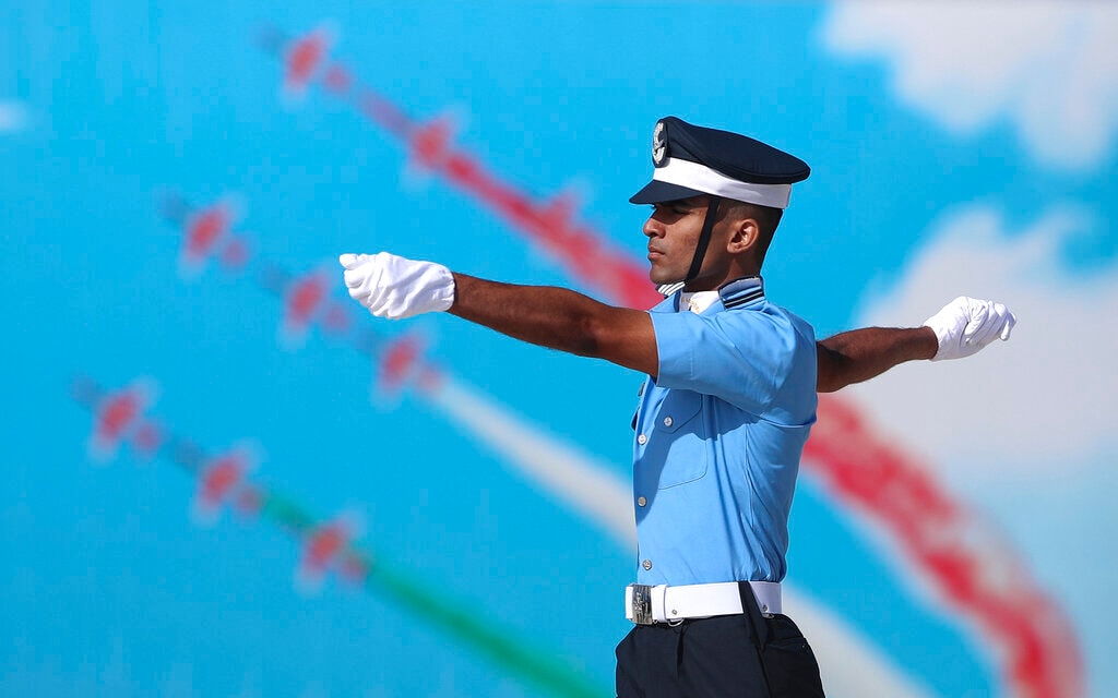 An Indian Air Force (IAF) cadet marches past a poster of aircrafts display during their graduation parade at the Air Force Academy in Dundigal, outskirts of Hyderabad, India, Saturday, June 15, 2019. A total of 152 flight cadets including 24 women officers were commissioned as flying officers on Saturday on successful completion of their training, a press release said. (AP Photo/Mahesh Kumar A.)