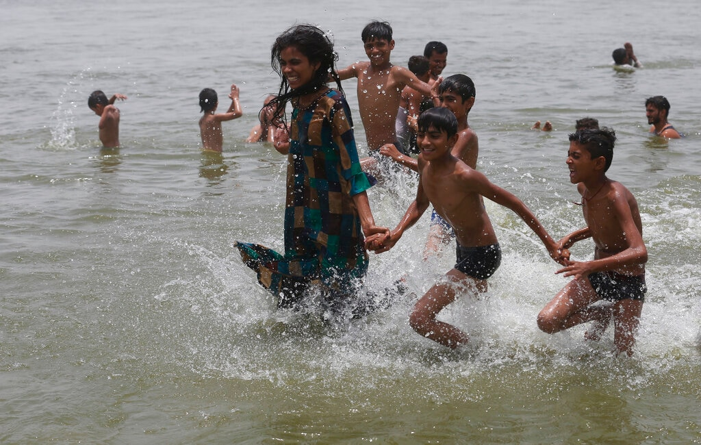 Children play in the River Ganges on a hot day in Prayagraj, India, Sunday, June 16, 2019. Many parts of India are experiencing extreme heat conditions. (AP Photo/Rajesh Kumar Singh)