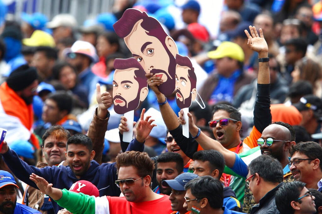 The Indian supporters at the ground show their admiration for Kohli. (AP Photo/Dave Thompson)