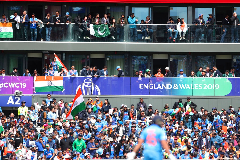 Spectators let their allegiance known at Old Trafford. (AP Photo/Aijaz Rahi)