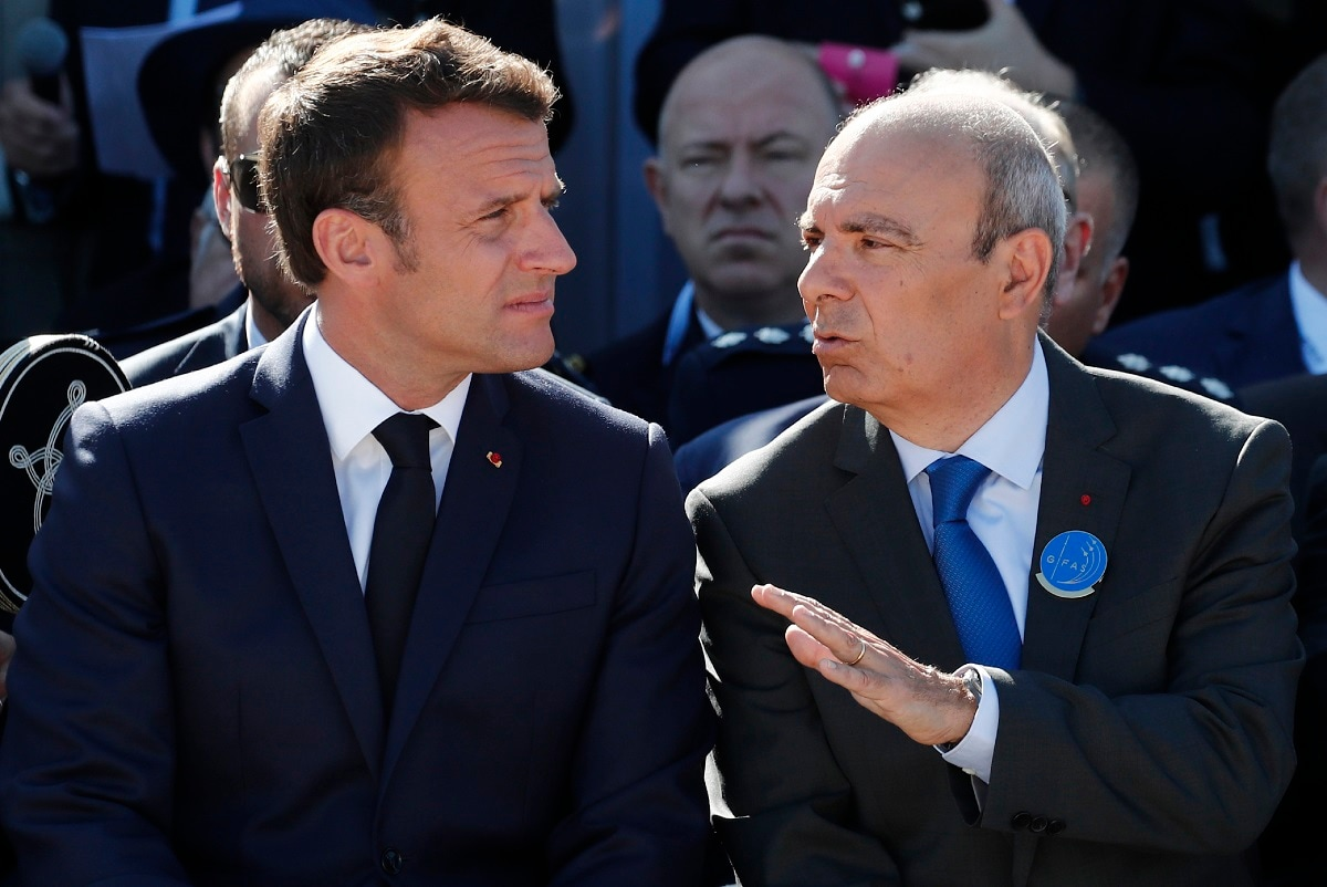 French President Emmanuel Macron, left, Eric Trappier, Chairman and CEO of Dassault Aviation attend the 53rd International Paris Air Show at Le Bourget Airport near Paris, France, Monday June 17, 2019. The world's aviation elite are gathering at the Paris Air Show with safety concerns on many minds after two crashes of the popular Boeing 737 Max. Benoit Tessier/Pool via AP