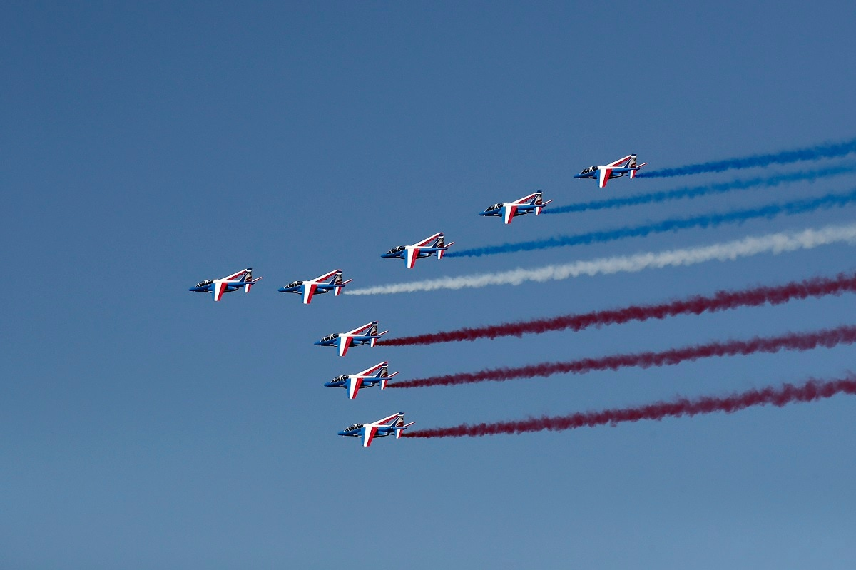 Alpha jets from the French Air Force Patrouille de France fly during the inauguration the 53rd International Paris Air Show at Le Bourget Airport near Paris. Benoit Tessier/Pool via AP