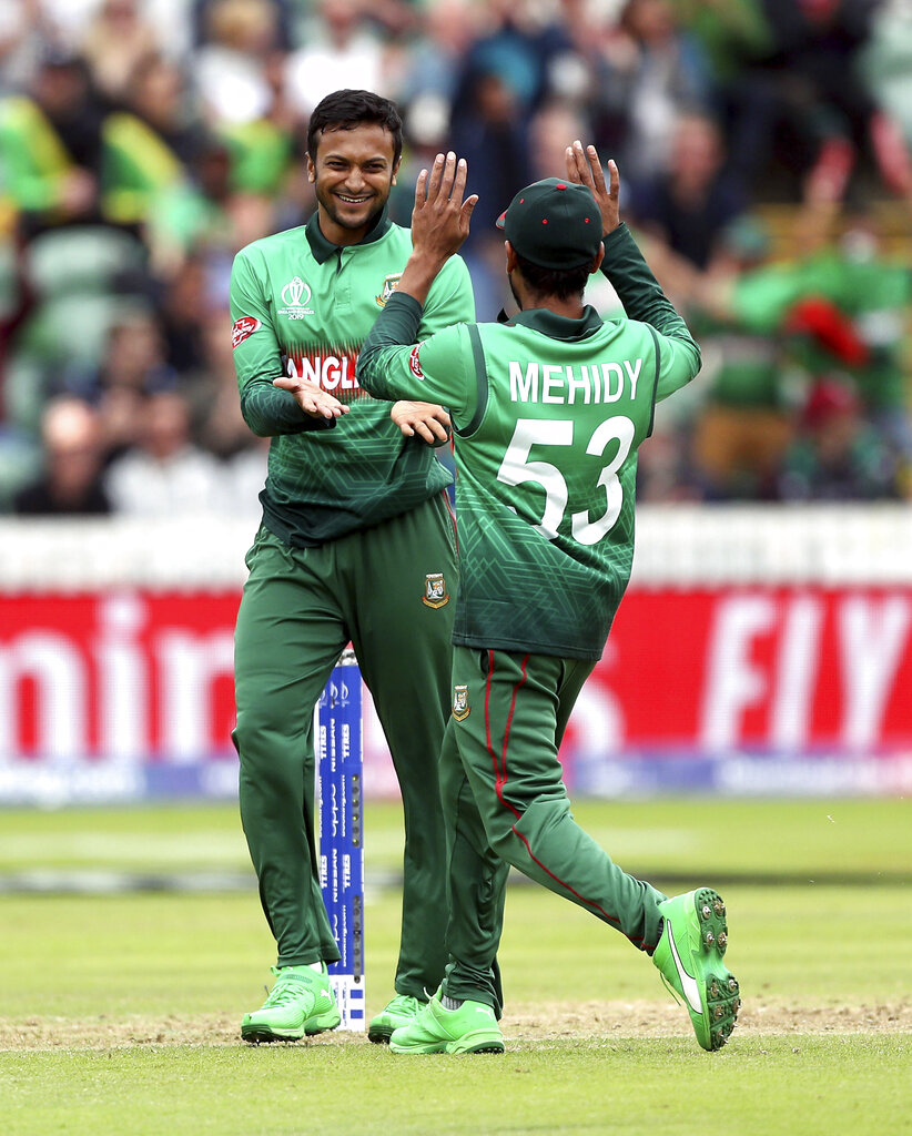 Bangladesh's Shakib Al Hasan, left, celebrates the wicket of West Indies' Evin Lewis during the Cricket World Cup match between West Indies and Bangladesh at The Taunton County Ground, Taunton, south west England, Monday June 17, 2019. (David Davies/PA via AP)