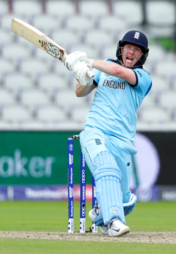 England's captain Eoin Morgan reacts after playing a shot during the Cricket World Cup match between England and Afghanistan at Old Trafford in Manchester, England, Tuesday, June 18, 2019. (AP Photo/Rui Vieira)