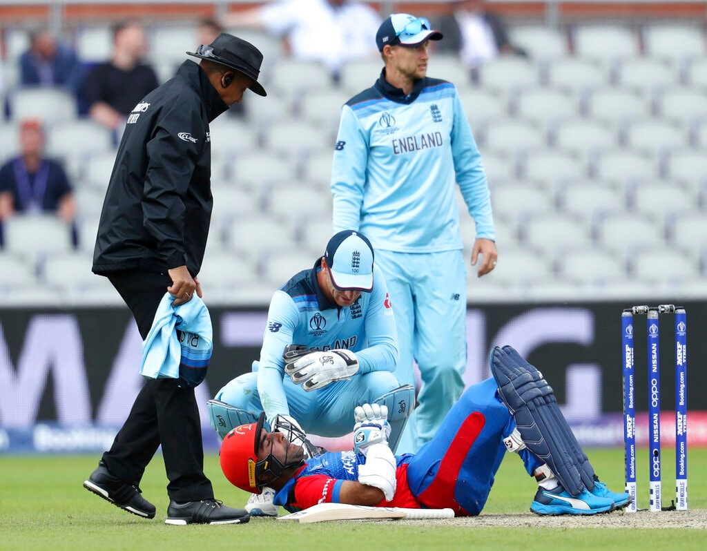 Afghanistan's Hashmatullah Shahidi lies on the ground after he was hit by the ball during the Cricket World Cup match between England and Afghanistan at Old Trafford in Manchester, England, Tuesday, June 18, 2019. (AP Photo/Rui Vieira)
