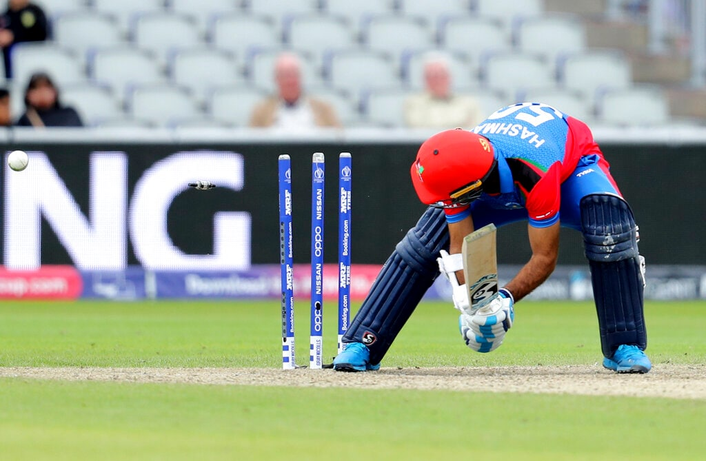Afghanistan's Hashmatullah Shahidi is bowled out by England's Jofra Archer during the Cricket World Cup match between England and Afghanistan at Old Trafford in Manchester, England, Tuesday, June 18, 2019. (AP Photo/Rui Vieira)