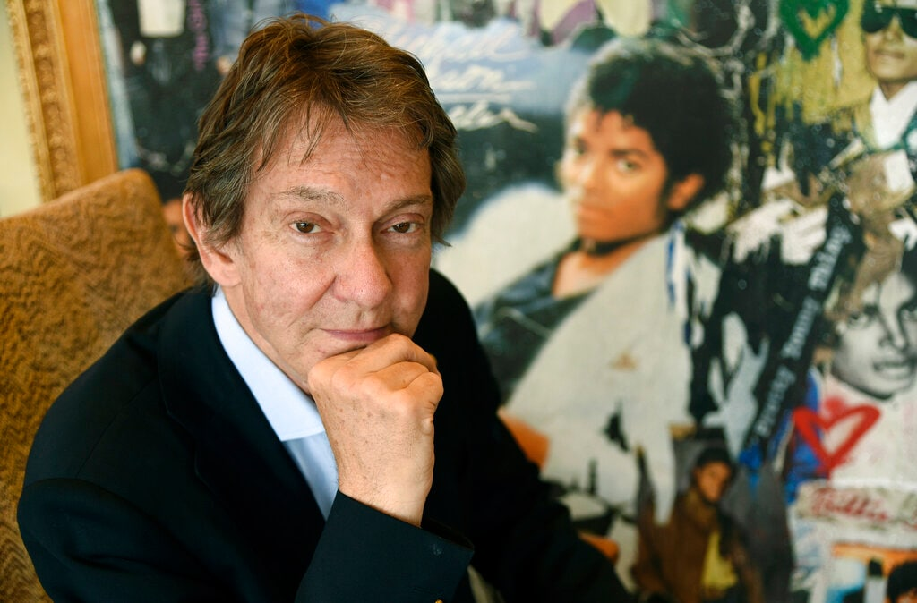 JOHN BRANCA, EXECUTOR OF ESTATE — Branca, an entertainment attorney who worked with Michael Jackson at the height of his fame in the 1980s, had just returned to Jackson's fold eight days before the singer's death. He has played a major role since then as the co-executor of Jackson's estate, turning nearly $500 million in debt into assets of over $1 billion. In this Tuesday, June 18, 2019 photo, Entertainment and corporate lawyer John Branca, the co-executor of Michael Jackson's estate, poses in his office next to an artwork presented to him from Sony Music commemorating the sale of 100 million copies of Michael Jackson's album