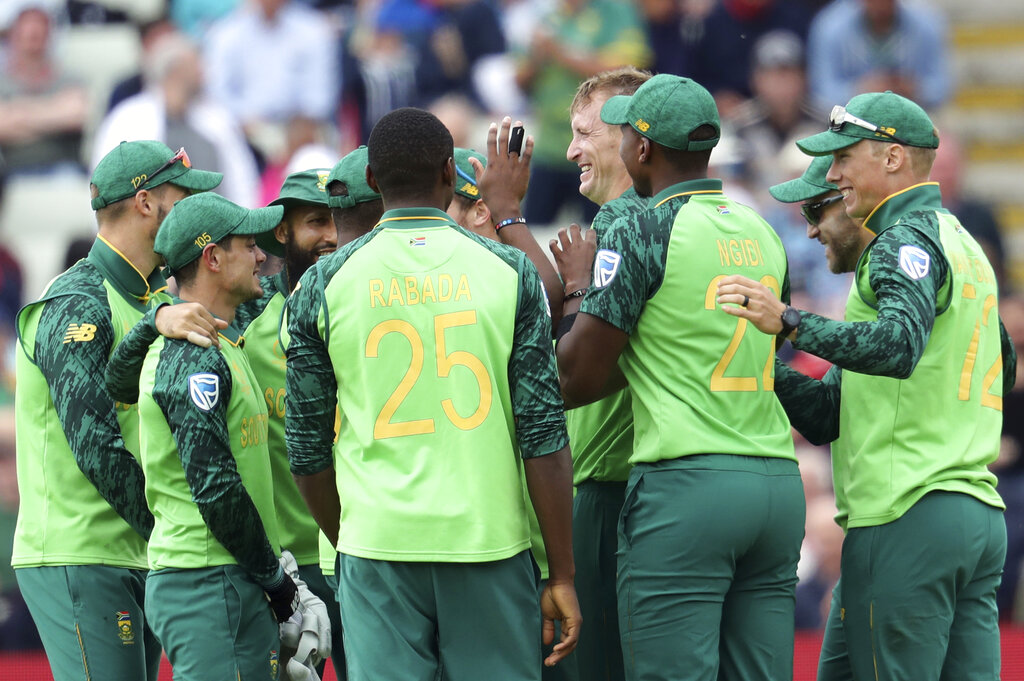 South Africa's bowler Chris Morris, middle, celebrates with teammates after dismissing New Zealand's batsman Tom Latham for 1 run during the Cricket World Cup match between New Zealand and South Africa at the Edgbaston Stadium in Birmingham, Wednesday, June 19, 2019. (AP Photo/Rui Vieira)