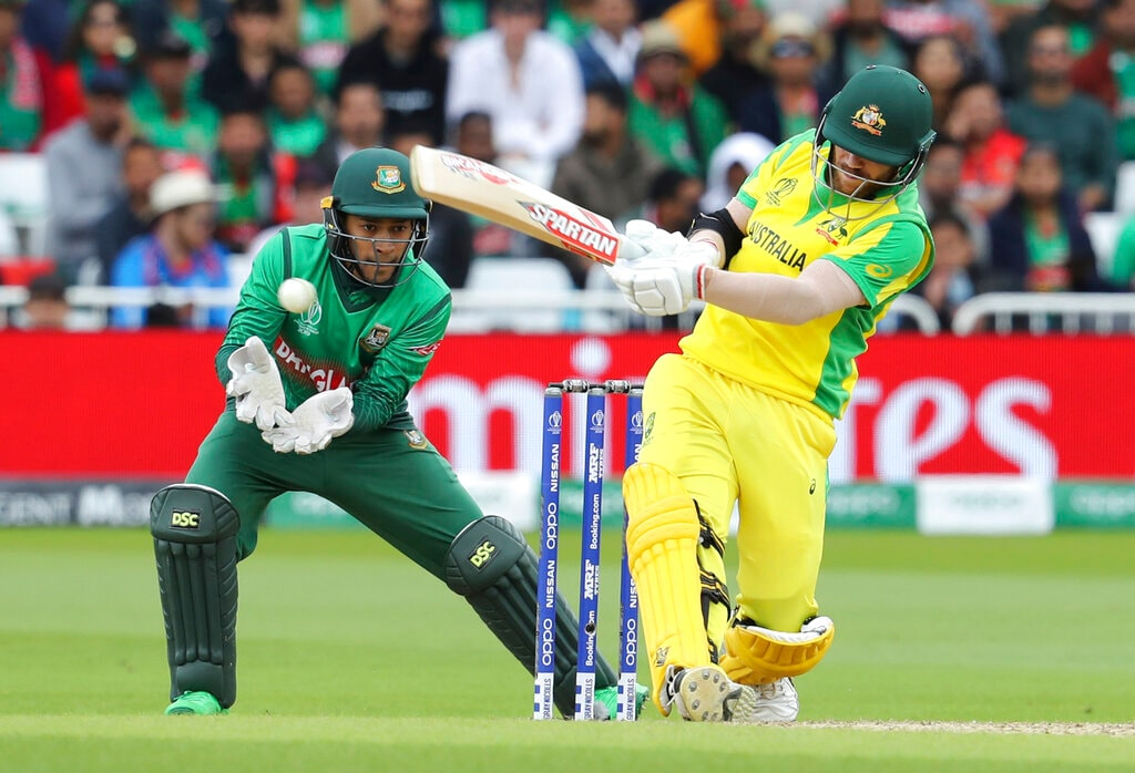 Australia's David Warner, right, bats during the Cricket World Cup match between Australia and Bangladesh at Trent Bridge in Nottingham, Thursday, June 20, 2019. (AP Photo/Rui Vieira)