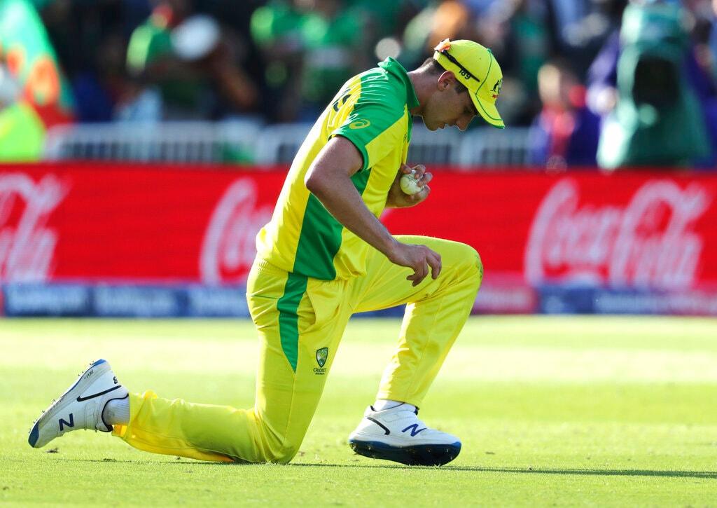 Australia's Pat Cummins takes the catch to dismiss Bangladesh's Mahmudullah during the Cricket World Cup match between Australia and Bangladesh at Trent Bridge in Nottingham, Thursday, June 20, 2019. (AP Photo/Rui Vieira)