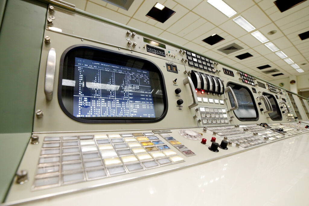 A rotary dial and other controls are shown on the console for the Instrumentation and Communications Officer, the 11th position on the third row inside the mission control room being restored to the Apollo mission era. June 17, 2019, in Houston. (AP Photo/Michael Wyke)