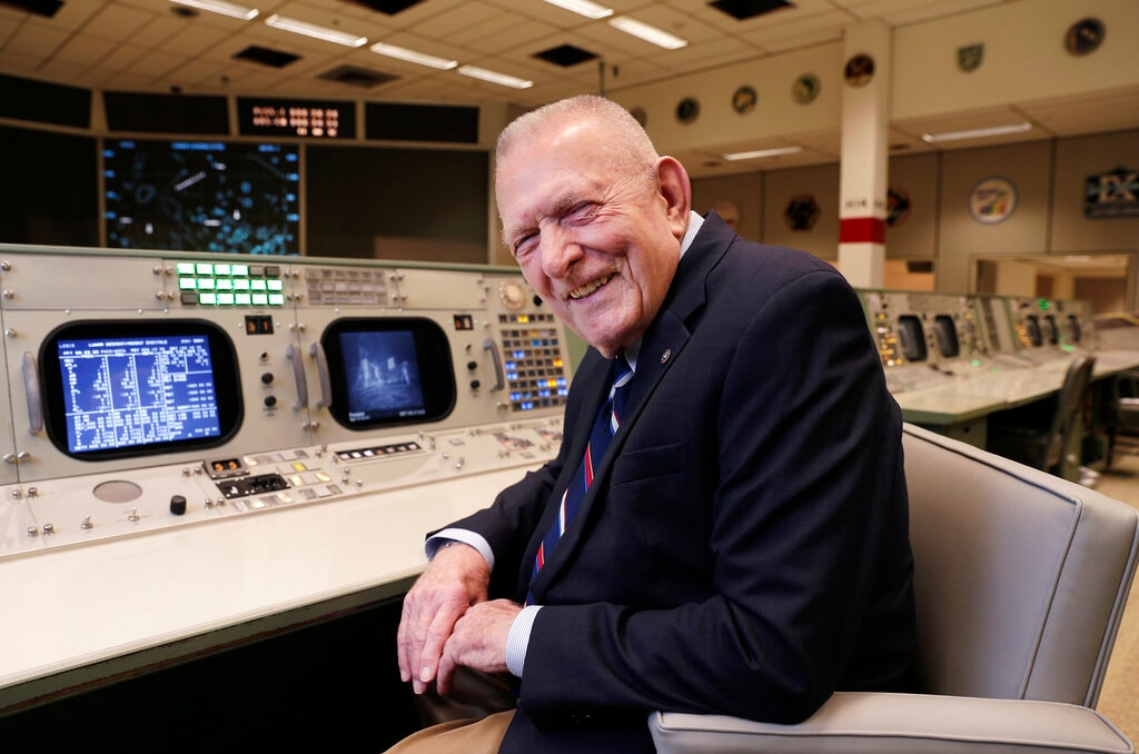 Gene Kranz, aerospace engineer, fighter pilot, an Apollo-era flight director and later director of NASA flight operations, sits at the console where he worked during the Gemini and Apollo missions at the NASA Johnson Space Center Monday, June 17, 2019, in Houston.