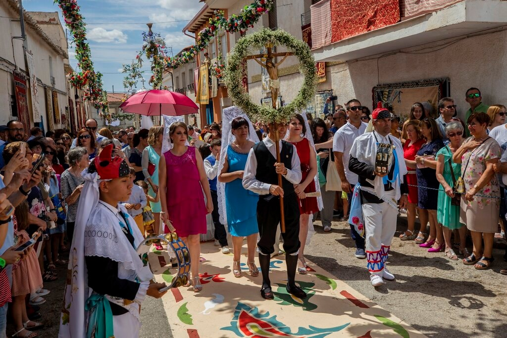 Villagers gather to see the sins and dancers procession during Corpus Christi celebrations in Camunas, central Spain. (AP Photo/Bernat Armangue)
