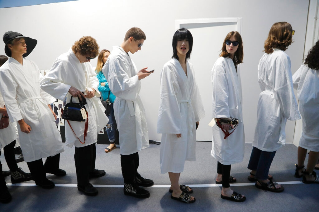 Models wait backstage prior to the Sacai mens Spring-Summer 2020 fashion collection presented in Paris, on June 22. (AP Photo/Michel Euler)