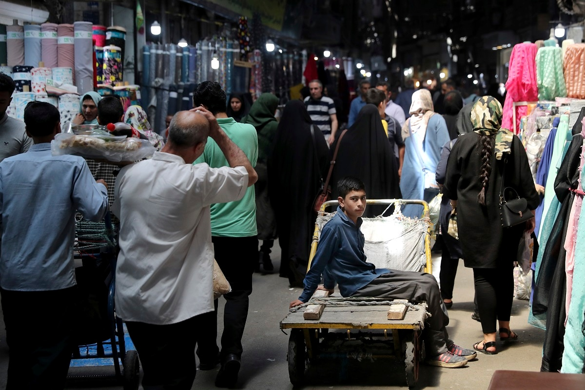 A young worker sits on his hand cart at the old main bazaar in Tehran. Many blame President Donald Trump and his maximalist policy on Iran, which has seen him pull out of Tehran's 2015 nuclear deal with world powers and levy punishing US sanctions on the country. (AP Photo/Ebrahim Noroozi)