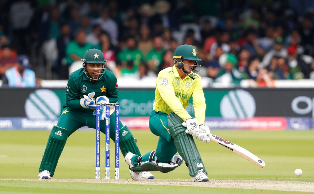South Africa's Quinton de Kock hits a single off the bowling of Pakistan's Shadab Khan during their Cricket World Cup match between Pakistan and South Africa at Lord's cricket ground in London, Sunday, June 23, 2019. (AP Photo/Alastair Grant)