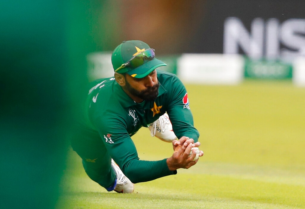 Pakistan's Mohammad Hafeez takesa catch to dismiss South Africa's Rassie van der Dussen during their Cricket World Cup match between Pakistan and South Africa at Lord's cricket ground in London, Sunday, June 23, 2019. (AP Photo/Alastair Grant)