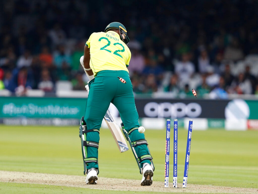 South Africa's Lungi Ngidi is clean bowled by Pakistan's Wahab Riaz during their Cricket World Cup match between Pakistan and South Africa at Lord's cricket ground in London, Sunday, June 23, 2019. (AP Photo/Alastair Grant)