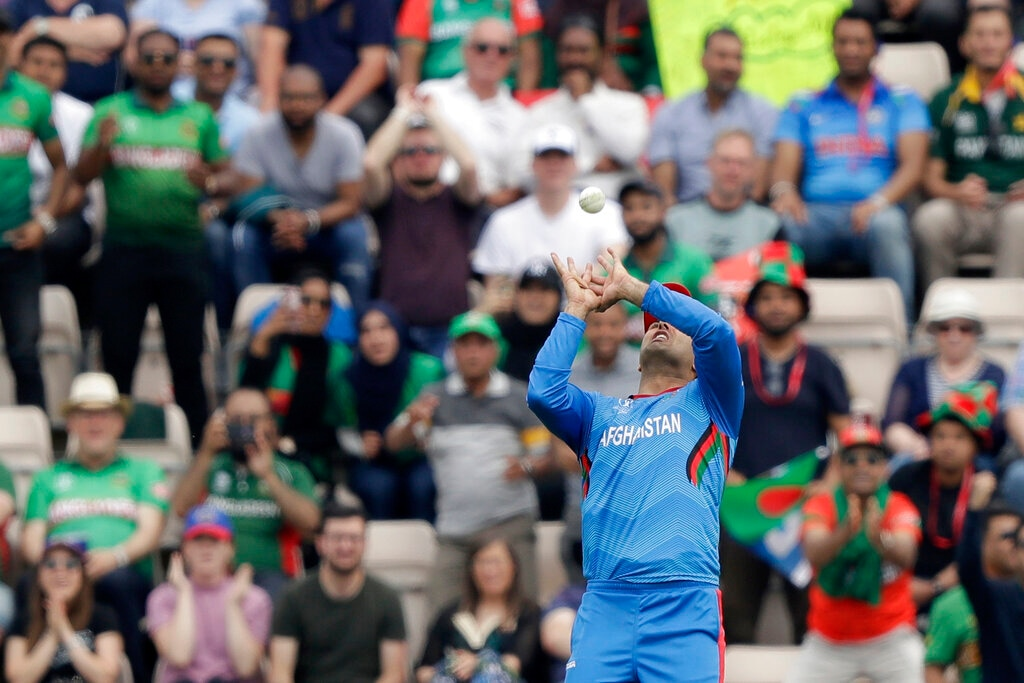 Afghanistan's Mohammad Nabi catches out Bangladesh's Mushfiqur Rahim during the Cricket World Cup match between Bangladesh and Afghanistan at the Hampshire Bowl in Southampton, England, Monday, June 24, 2019. (AP Photo/Matt Dunham)