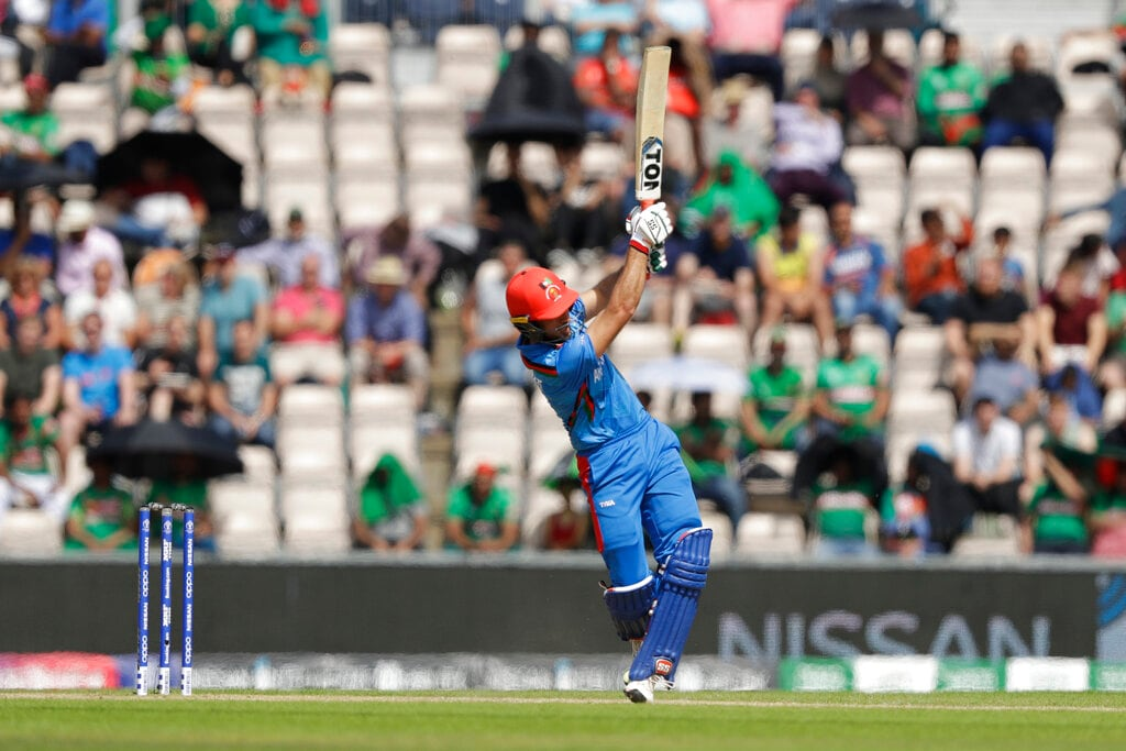 Afghanistan's Rahmat Shah hits a shot during the Cricket World Cup match between Bangladesh and Afghanistan at the Hampshire Bowl in Southampton, England, Monday, June 24, 2019. (AP Photo/Matt Dunham)