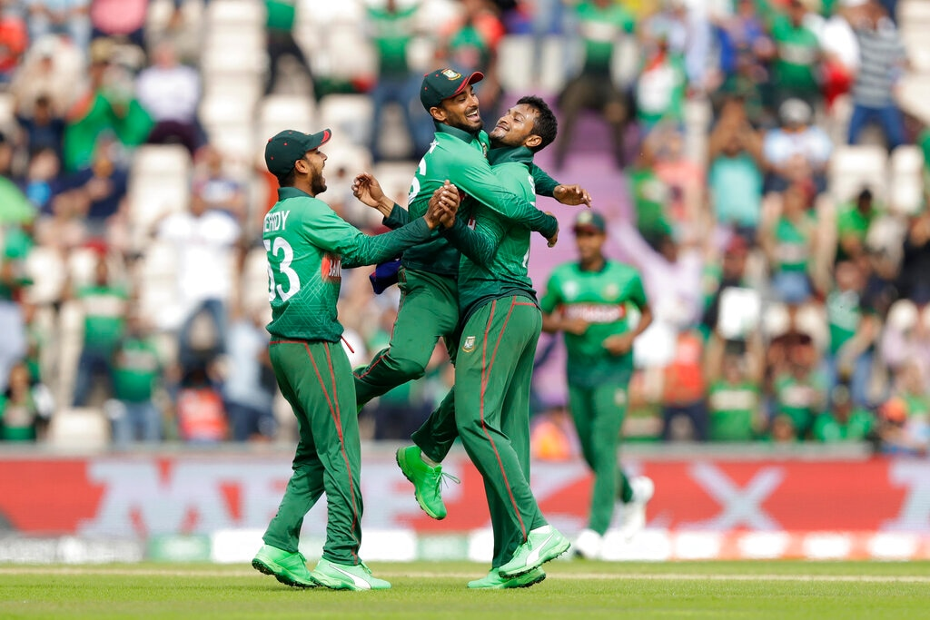 Bangladesh's Shakib Al Hasan, right, celebrates taking the wicket of Afghanistan's Mohammad Nabi during the Cricket World Cup match between Bangladesh and Afghanistan at the Hampshire Bowl in Southampton, England, Monday, June 24, 2019. (AP Photo/Matt Dunham)