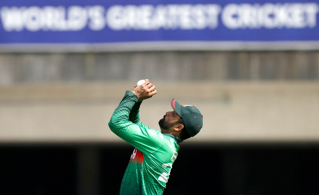 Bangladesh's Tamim Iqbal catches out Afghanistan's Rahmat Shah during the Cricket World Cup match between Bangladesh and Afghanistan at the Hampshire Bowl in Southampton, England, Monday, June 24, 2019. (AP Photo/Matt Dunham)